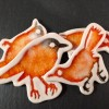 Brooches: orange
